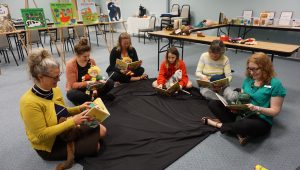Sharing board books with little ones.
