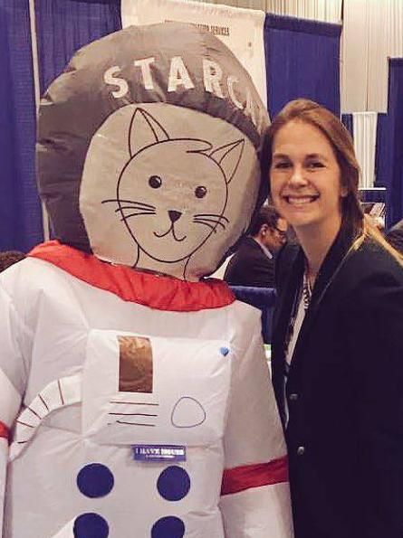 Erika Jenns posing with STLS mascot STARCat